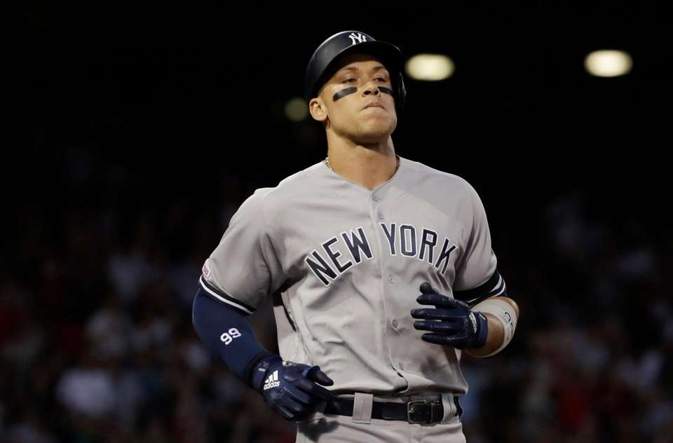New York Yankees' Aaron Judge reacts after flying