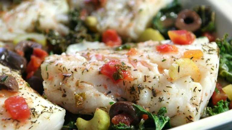 Cod baked in kale, tomatoes, olives and celery