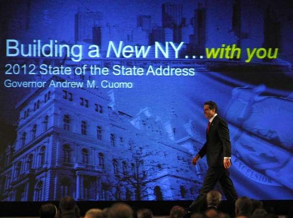New York Gov. Andrew Cuomo walks to the