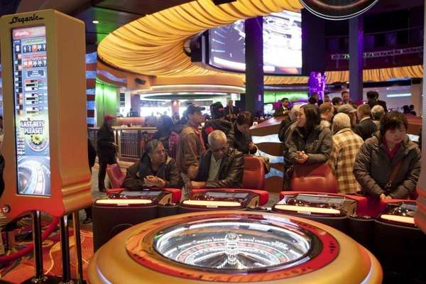 People play video roulette at the Resorts World