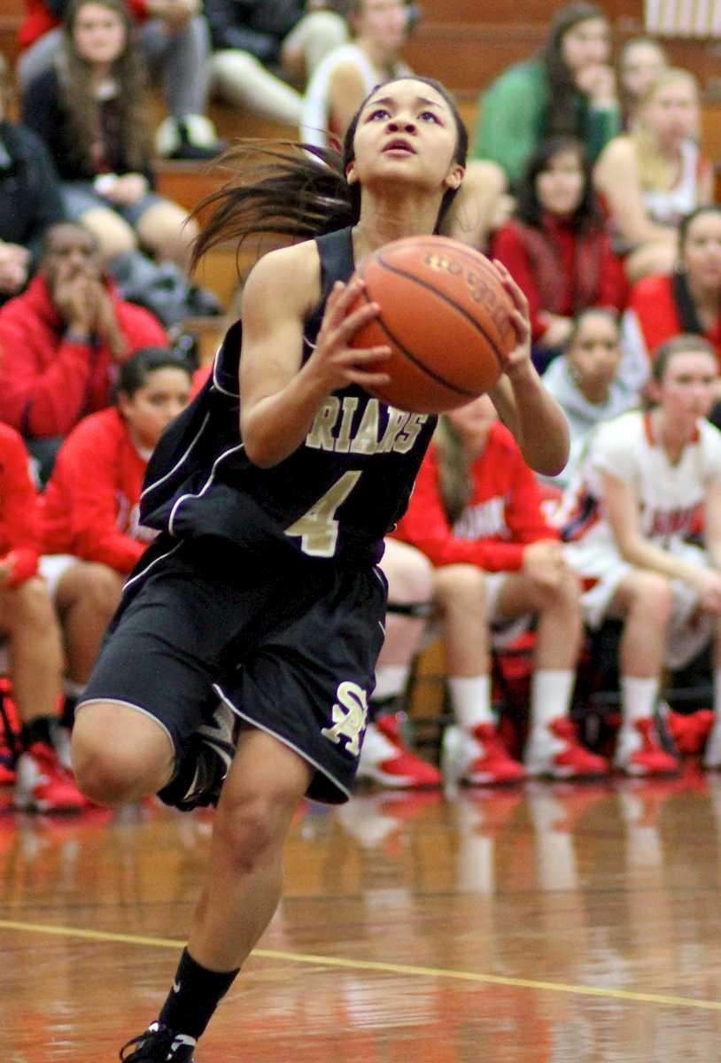 St. Anthony's Tyla Parham #4 drives to the