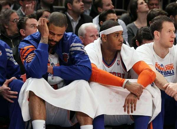 Carmelo Anthony and Tyson Chandler look on late