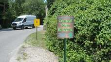 One of the signs installed in Quogue and