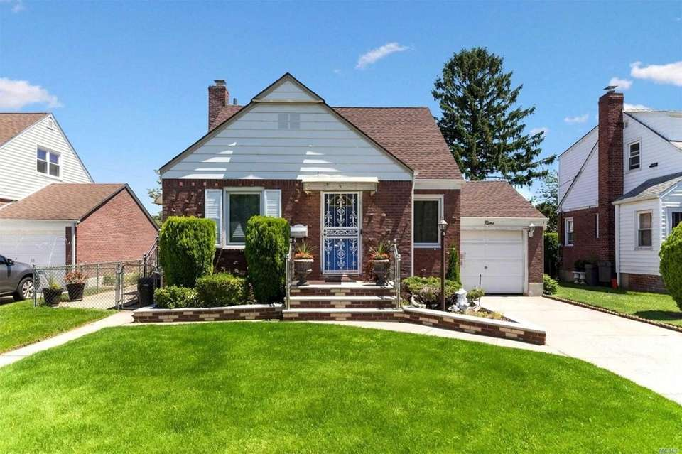 This Elmont Cape includes four bedrooms and one