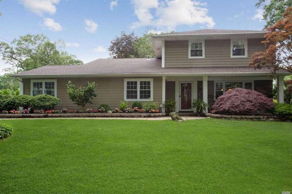 This Huntington splanch includes four bedrooms and 2