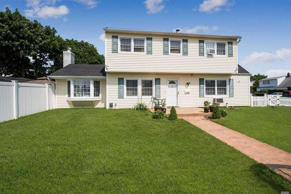 This Levittown Colonial includes four bedrooms and two
