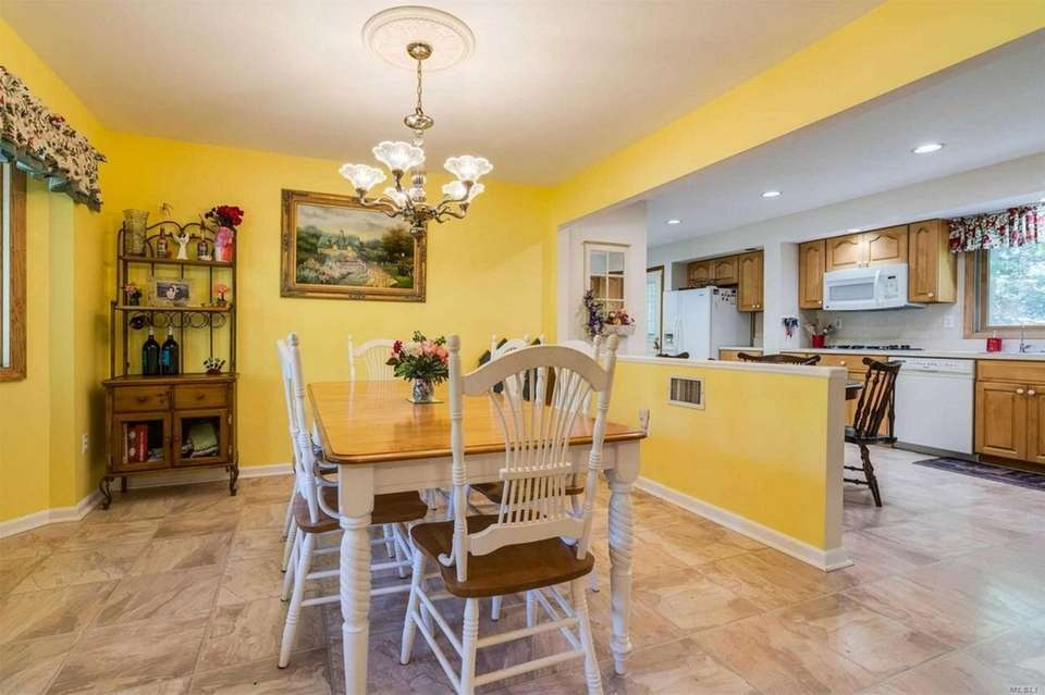 The main level includes a foyer, living room,