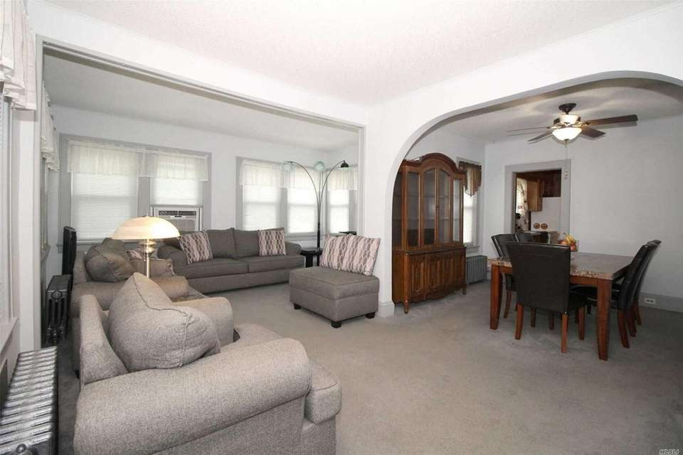 The house features a living room, dining room,
