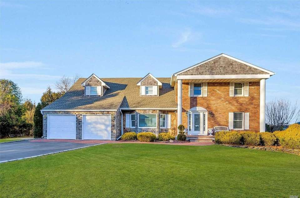 This Miller Place traditional includes five bedrooms and