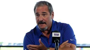 Giants general manager Dave Gettleman talks to the