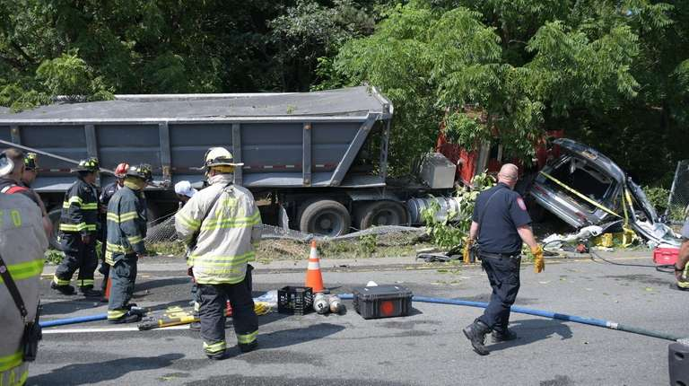 Woman struck, killed by Mack truck in East Hills, police say