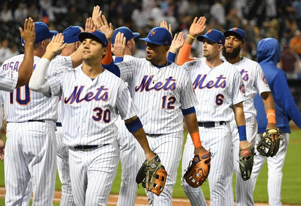 New York Mets players celebrate their 6-3 win