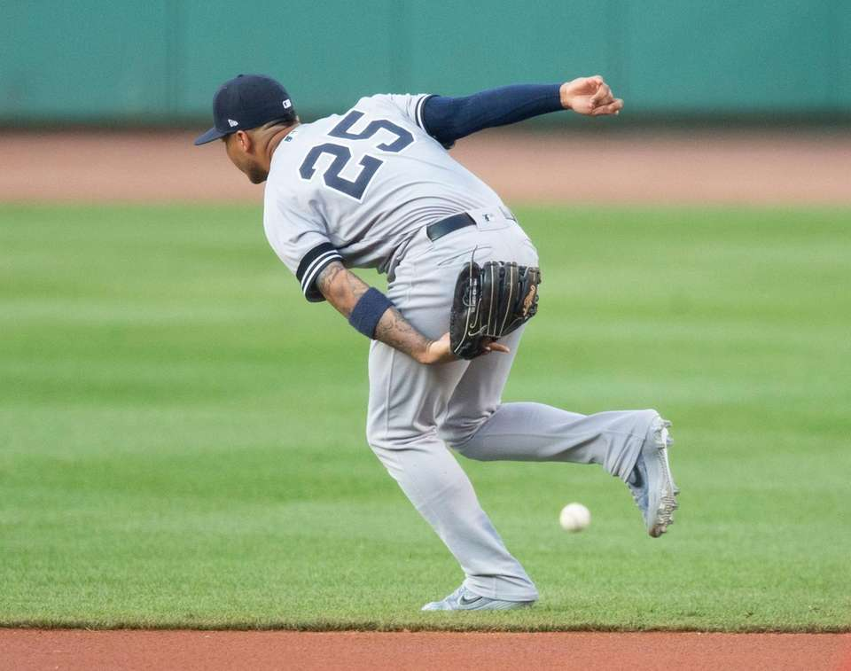 The ball gets past Yankees second baseman Gleyber