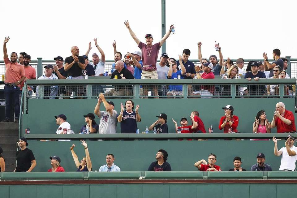Fans in the Green Monster react after Mookie