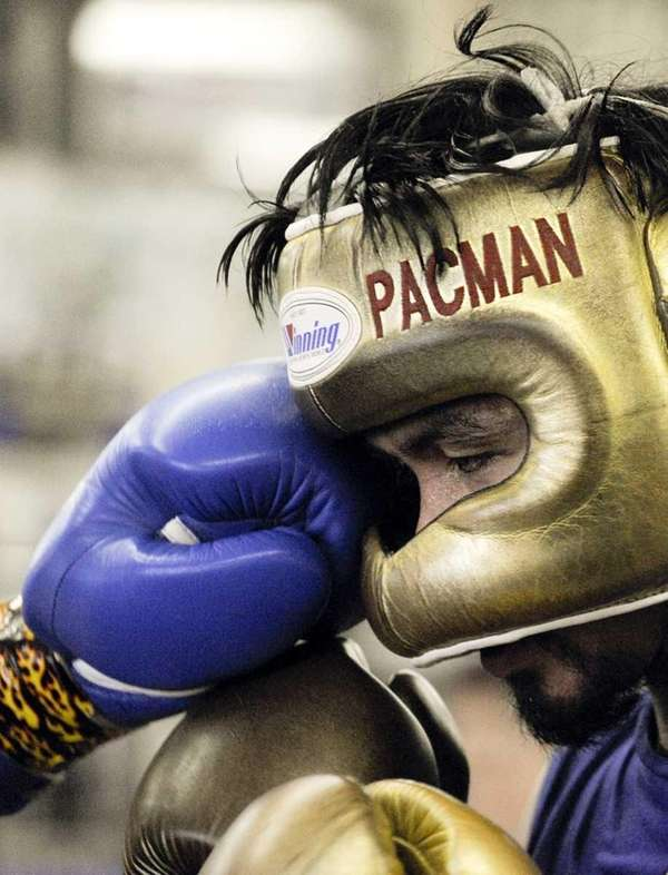 Manny Pacquiao spars at the Wild Card Boxing