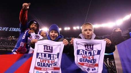 Fans celebrate after the New York Giants defeated