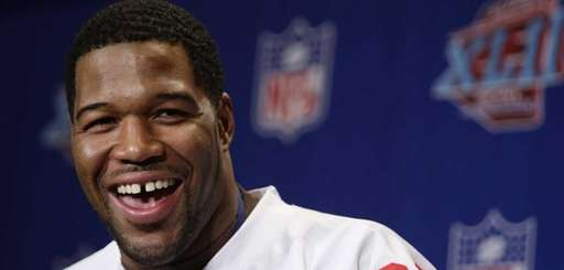 Ex-Giant Michael Strahan speaks during a press conference.