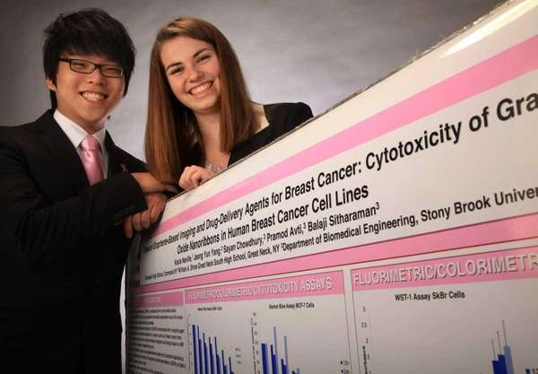 Student scientists John Yang, 18, and Kayla Neville,