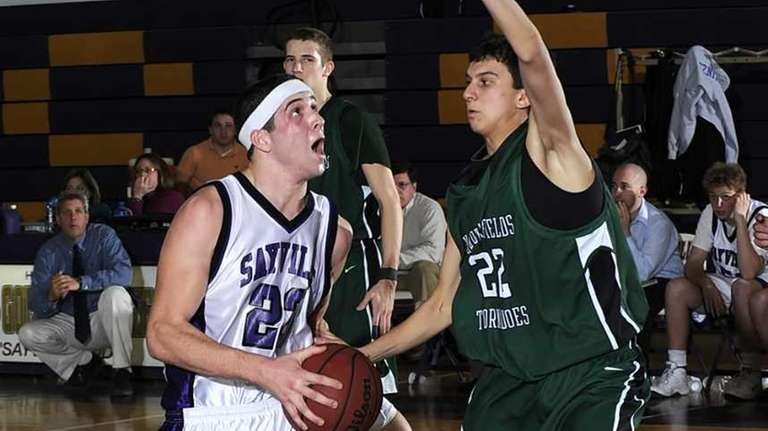 Sayville's James Rupp (23) drives hard to the