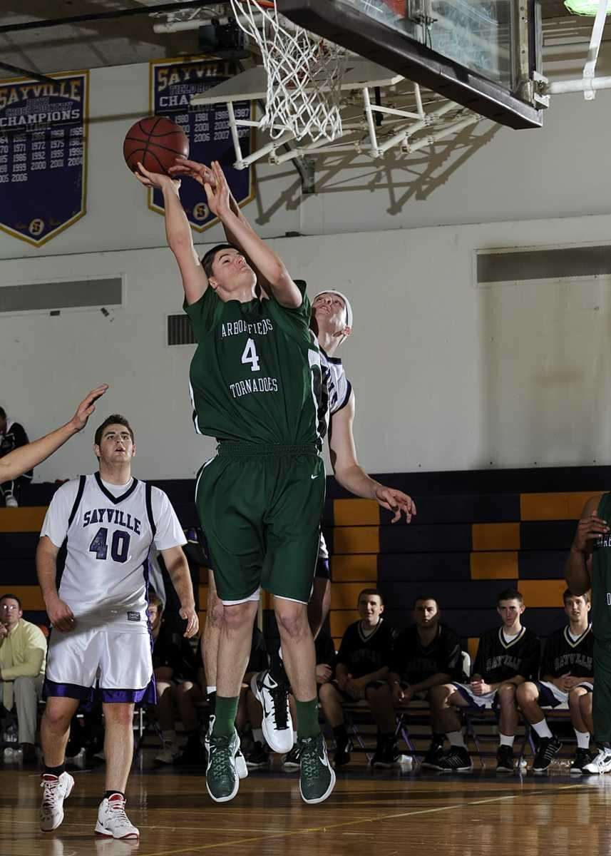 Harborfield's Justin Ringen (4) scores the layup and