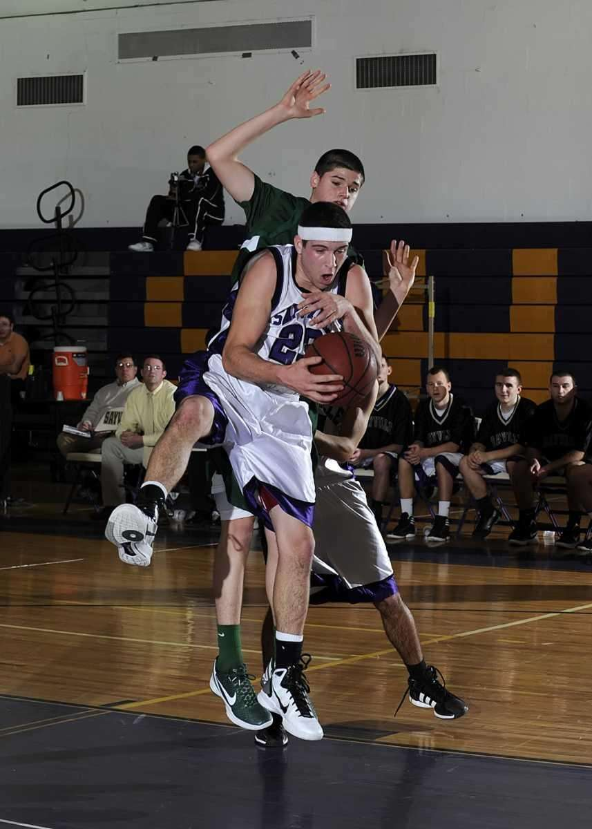 Sayville's James Rupp (23) makes the rebound. (Jan.