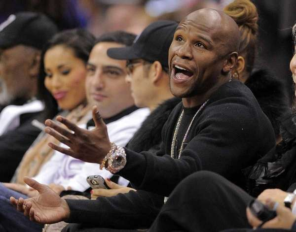 Boxer Floyd Mayweather talks to a referee as