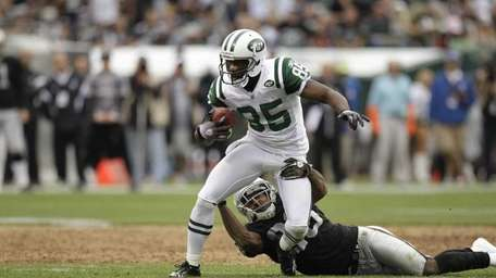 Jets wide receiver Derrick Mason in action against