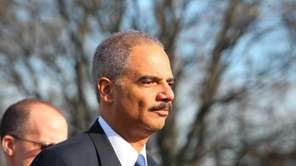 Attorney General Eric Holder attends the funeral for