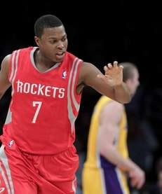 Houston Rockets' Kyle Lowry slaps hands with a