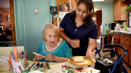 Alma Gonzalez, a home health aide, makes lunch