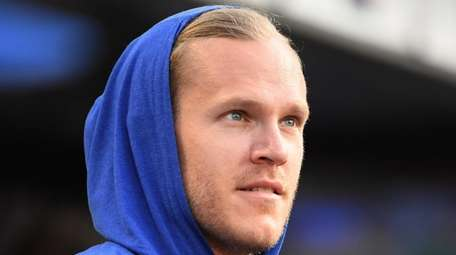 Noah Syndergaard looks on from the dugout before