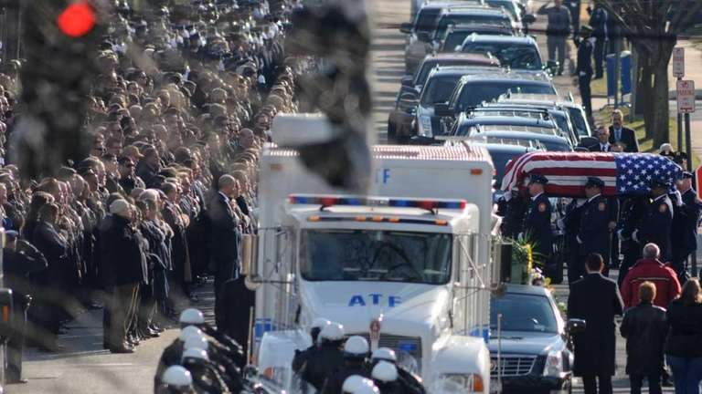 ATF agent John Capano's coffin is carried out