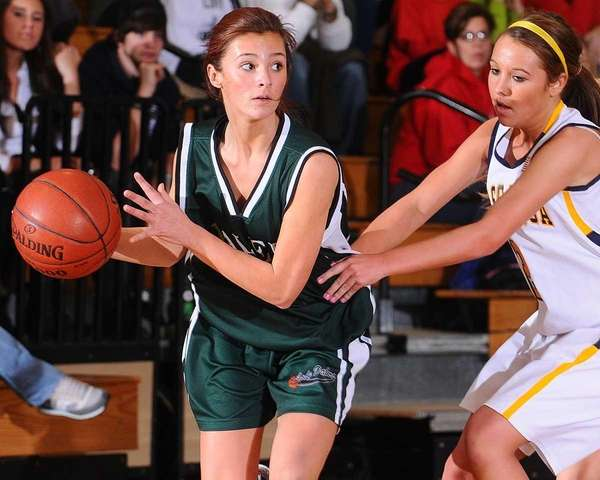 Farmingdale High School #24 Alexis Panariello, left, looks