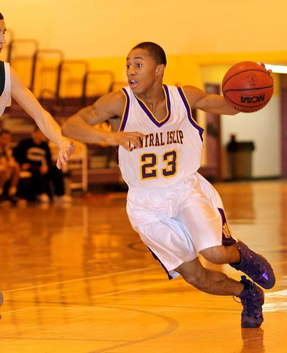 Central Islip's Jasean Percell moves the ball against
