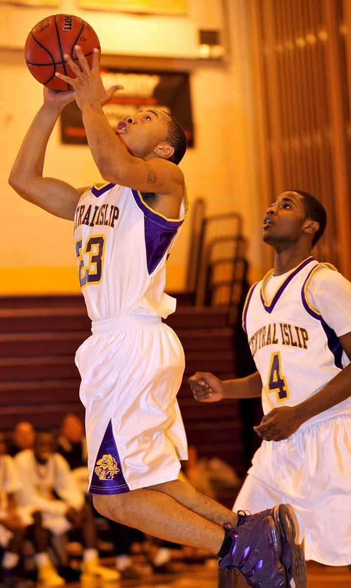 Central Islip G Jasean Percell #23 drives to