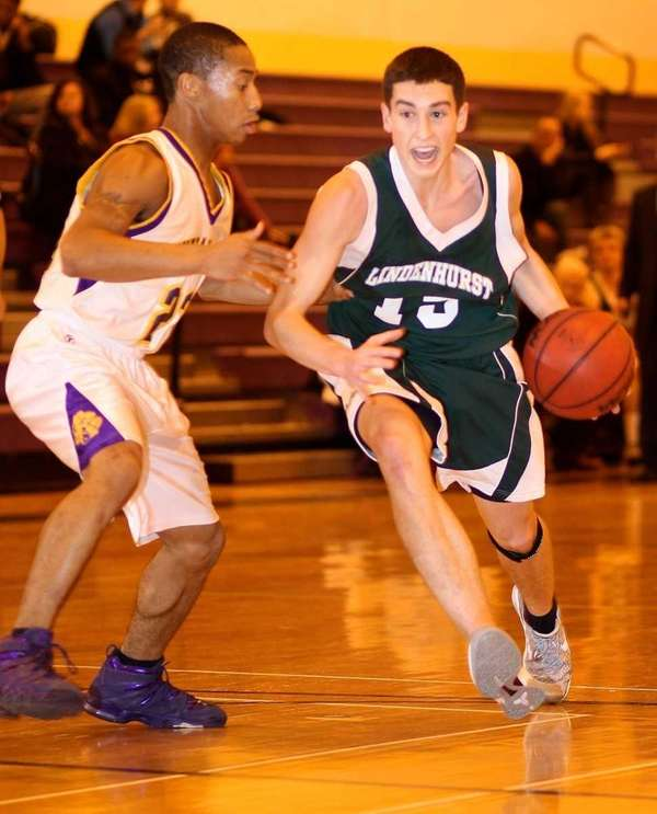 Lindenhurst guard Aaron Coughlin drives the paint as