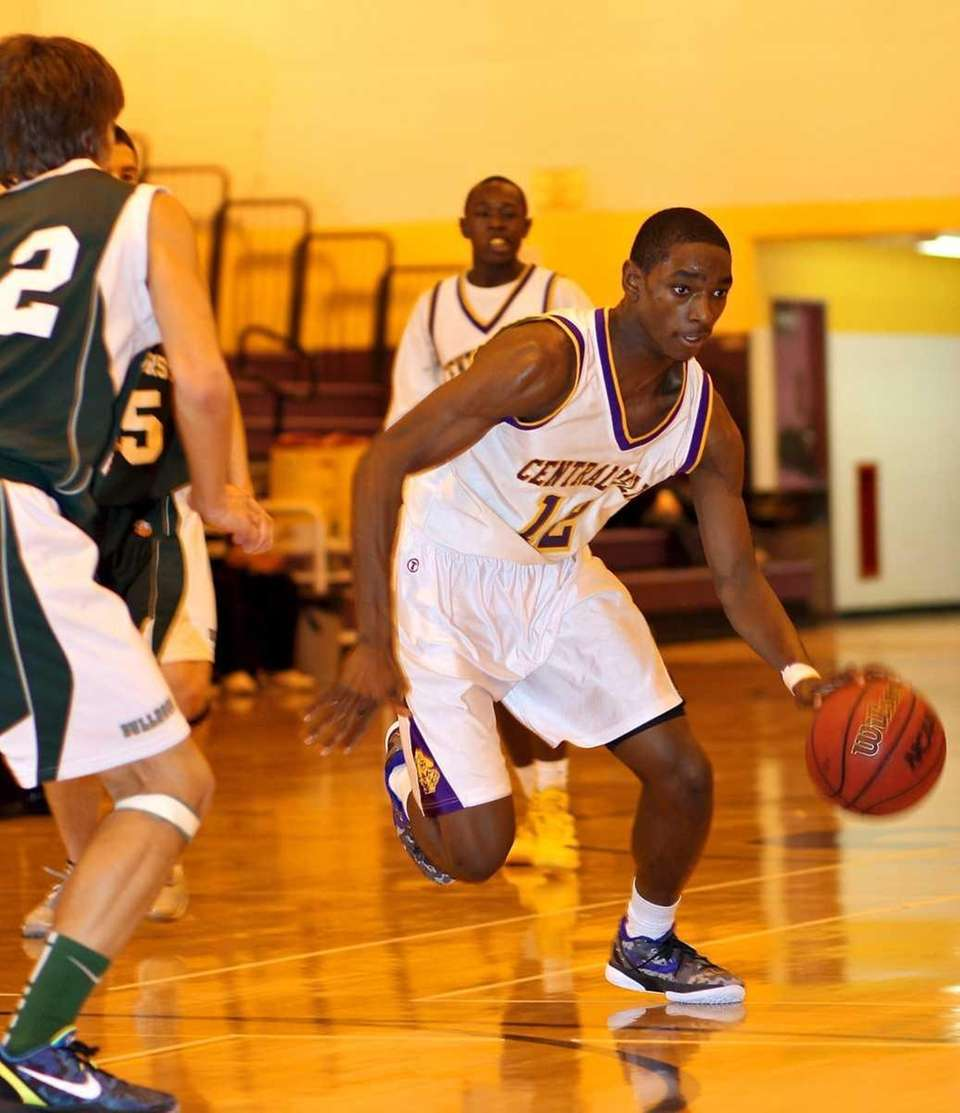 Central Islip F Timothy McKenzie #12 moves the