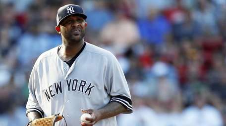 Yankees' CC Sabathia stands on the mound during
