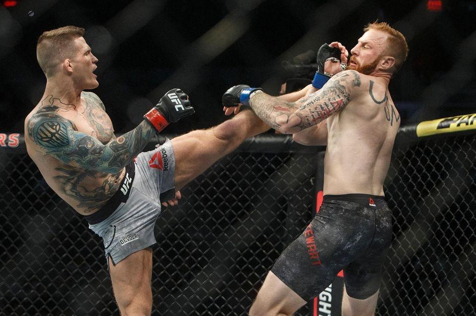 Erik Koch, left, kicks Kyle Stewart during a