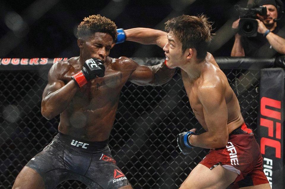 Hakeem Dawodu, left, is hit by Yoshinori Horie