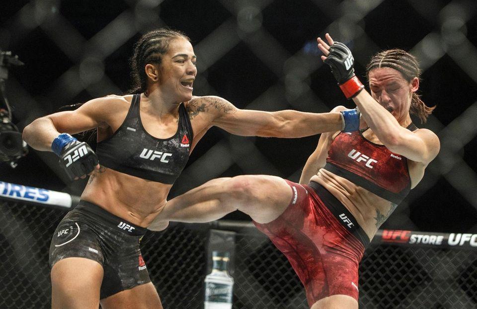Alexis Davis, right, is hit by Viviane Araujo