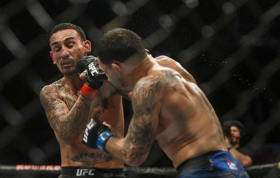 Max Holloway is hit by Frankie Edgar during
