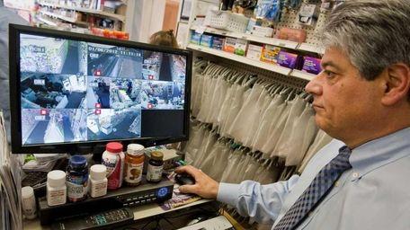 Don Cantalino exhibits his newly installed surveillance cameras