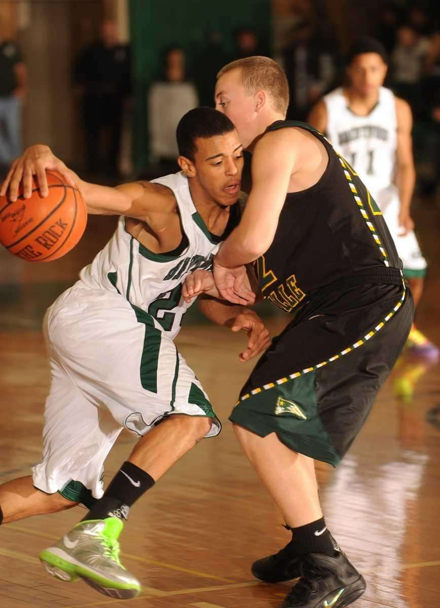 Brentwood's #23 Lawrence Hall, left, collides with Ward