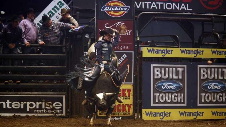 Cowboy Luke Snyder is seen riding a bull