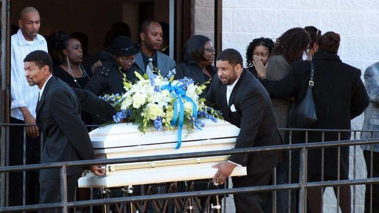The coffin of 2-year-old Jaiden Planter is taken
