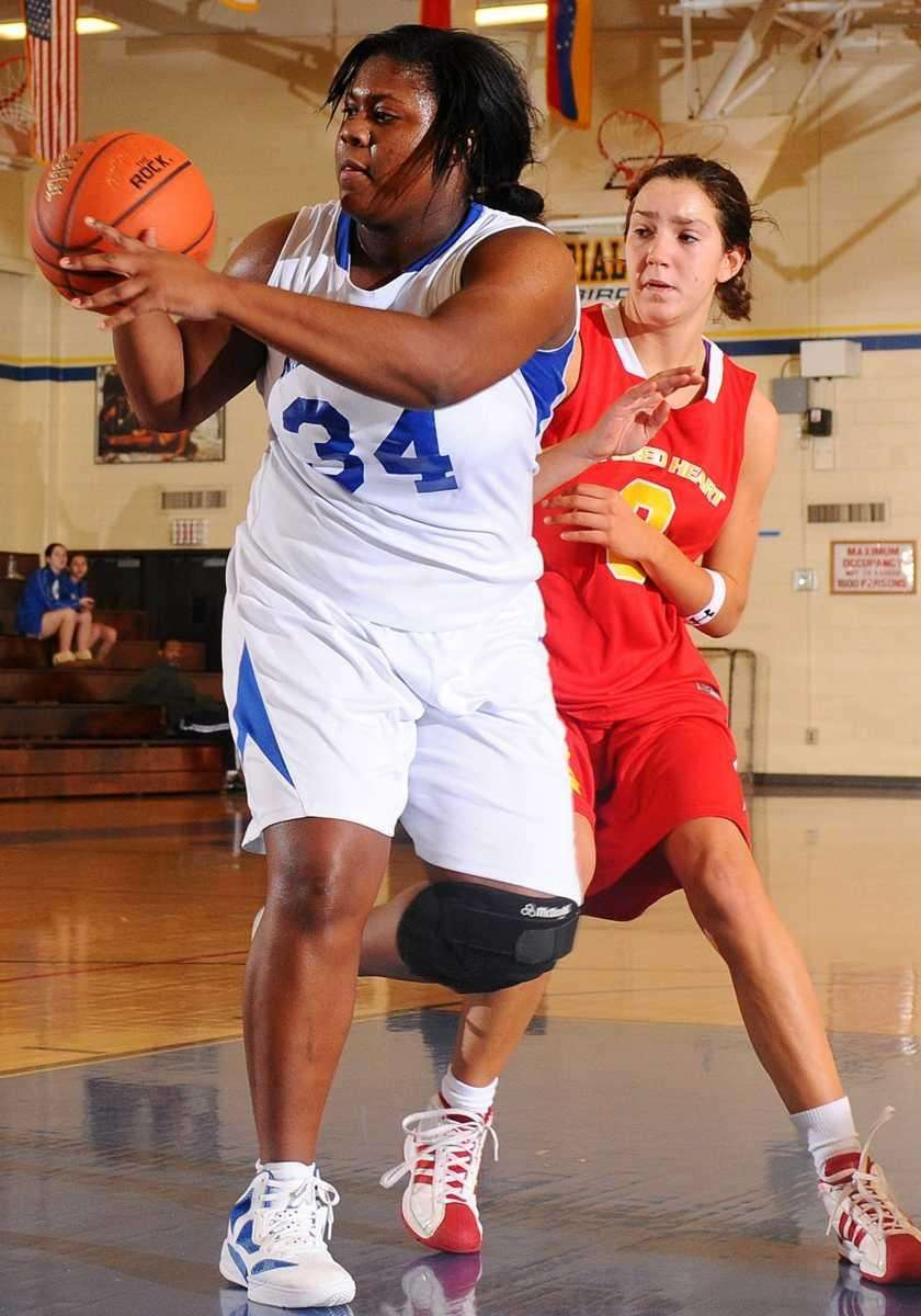 Kellenberg High School #34 Khadijah Donaldson, left, gets