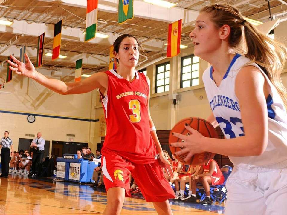 Sacred Heart Academy #3 Nina Corcoran, left, defends