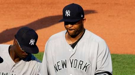Yankees starting pitcher CC Sabathia hands over the