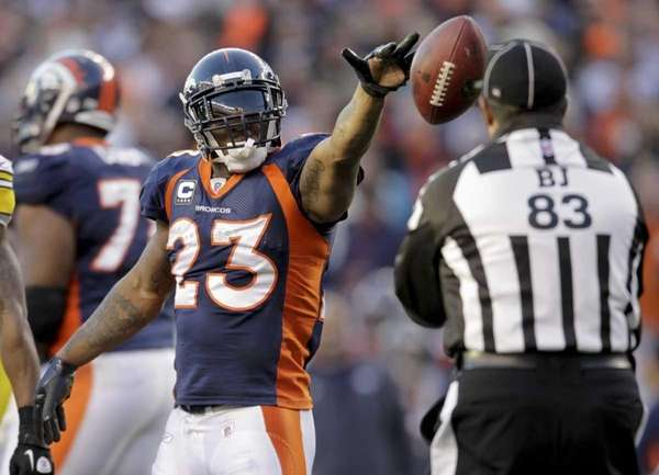 Denver Broncos running back Willis McGahee (23) flips